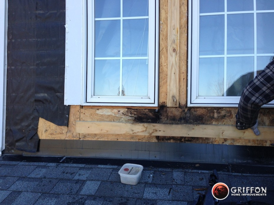 Removing old siding with old wood & plywood